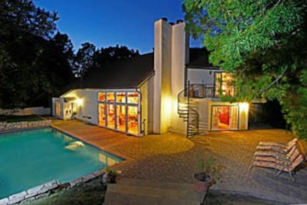 Back View of Estate at Sunset showing Living Room wall of French Doors and Large Pool!