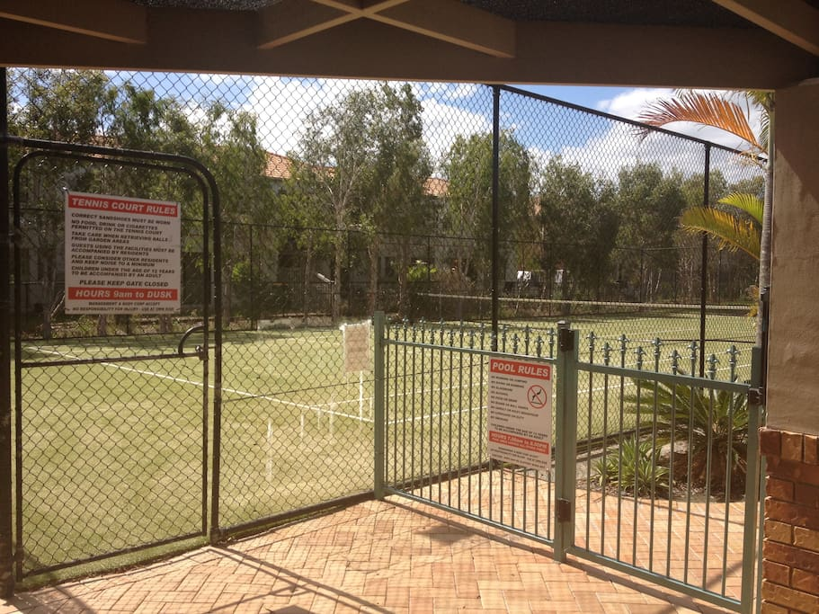 Full size tennis court inluding rackets and balls.