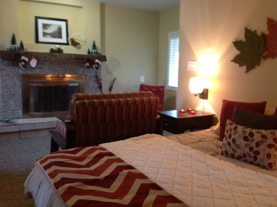 The Master Bedroom awaits with a fireplace and cozy sitting room for sipping Hot Chocolate on winter days!
