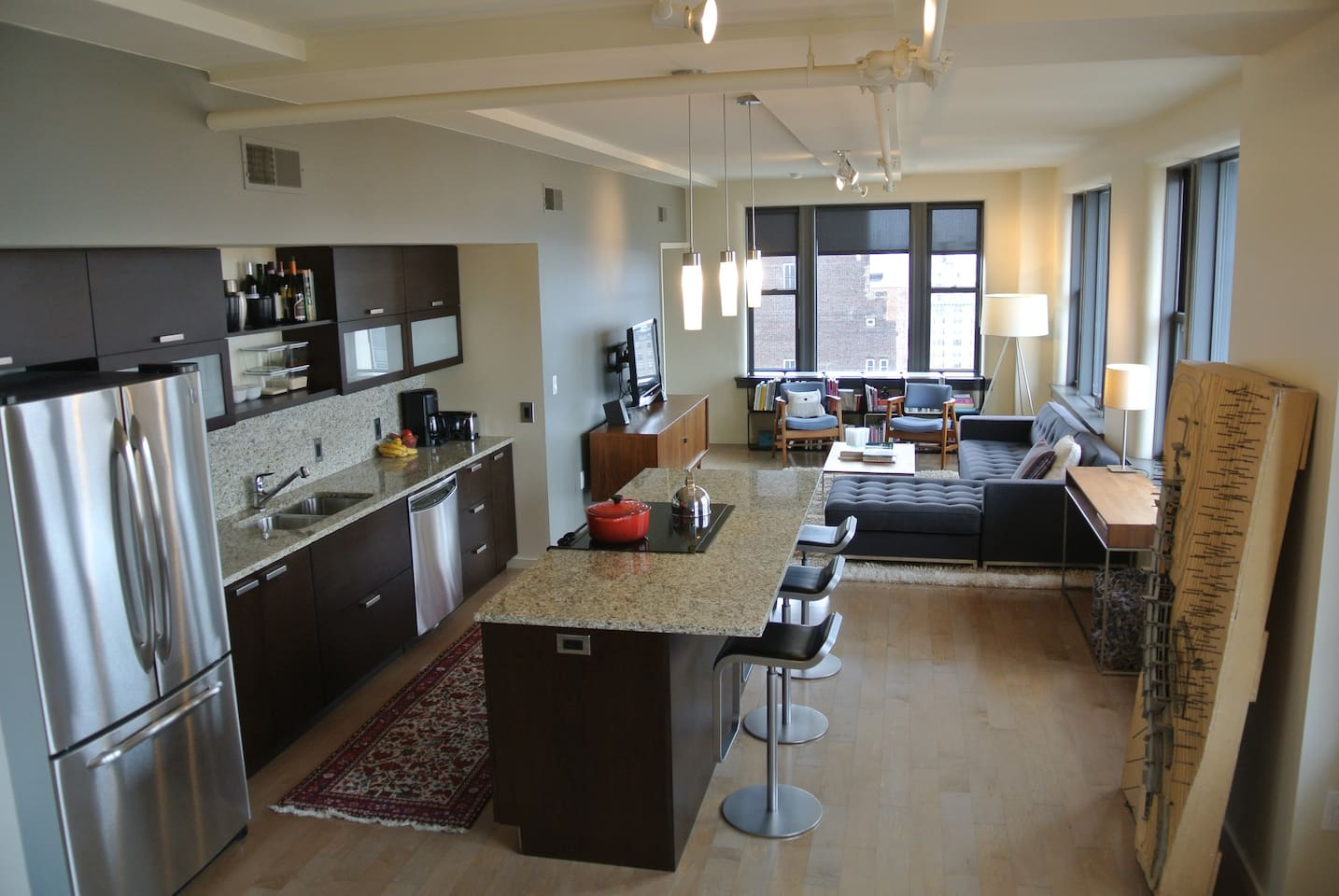 Open plan city living with high-end furnishings, tons of natural light and amazing views!
