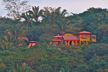 The Sunset Suite is the upstairs bedroom and private bathroom with panoramic ocean and jungle views from the balcony ideal for bird and monkey watching. It is also the perfect spot to relax and watch the breathtaking sunsets!
