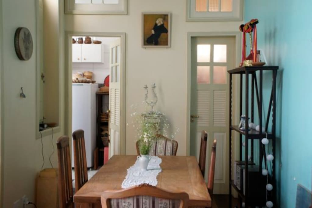 The dining area, looking into the kitchen on the left, and the bathroom door on the right