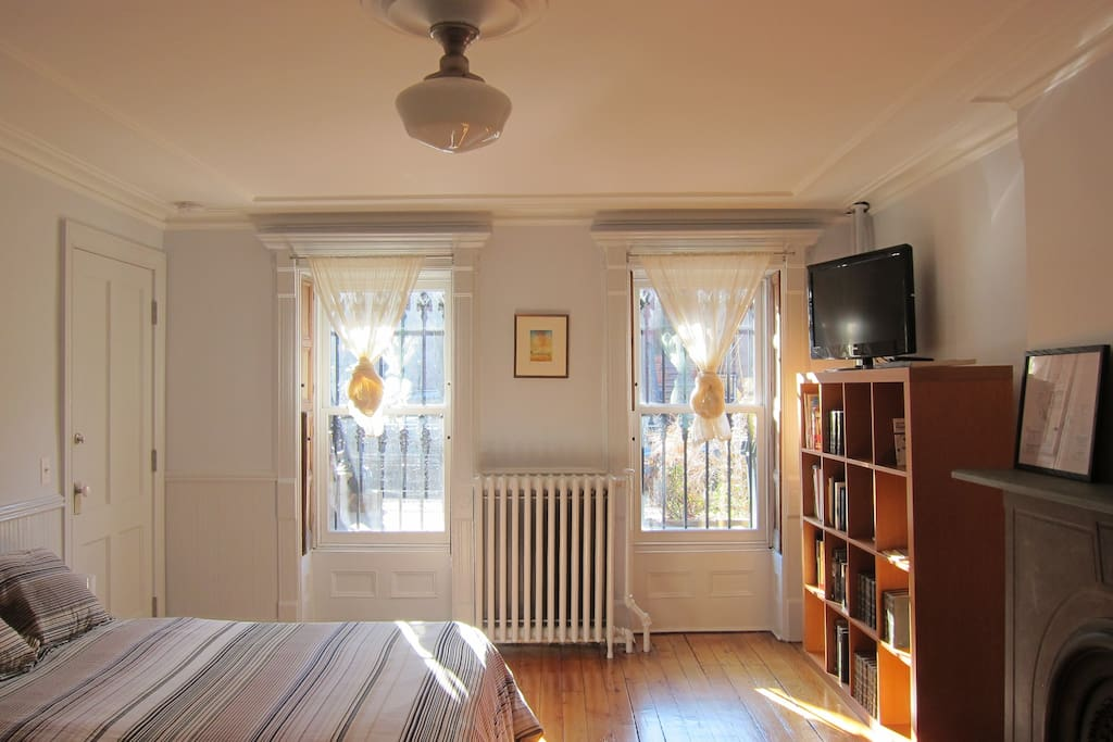 Looks out over lovely garden on a quiet and charming residential street.