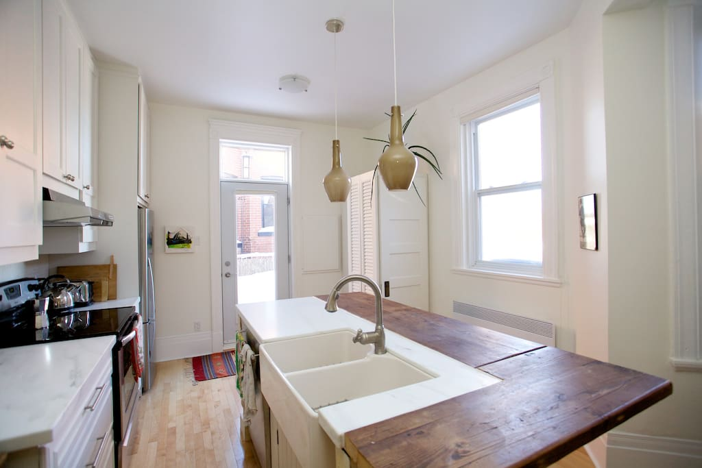 Open concept: living room, bright and beautiful newly renovated kitchen with new electrical appliances