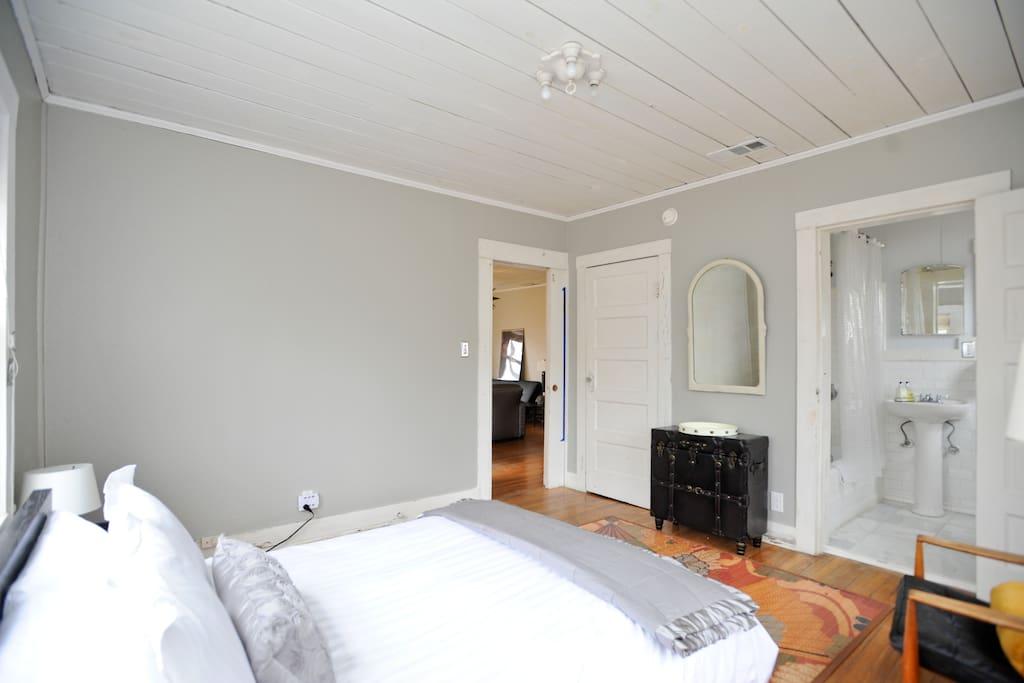 bedroom 1 (showing bathroom door on right and doorway to living area straight ahead)