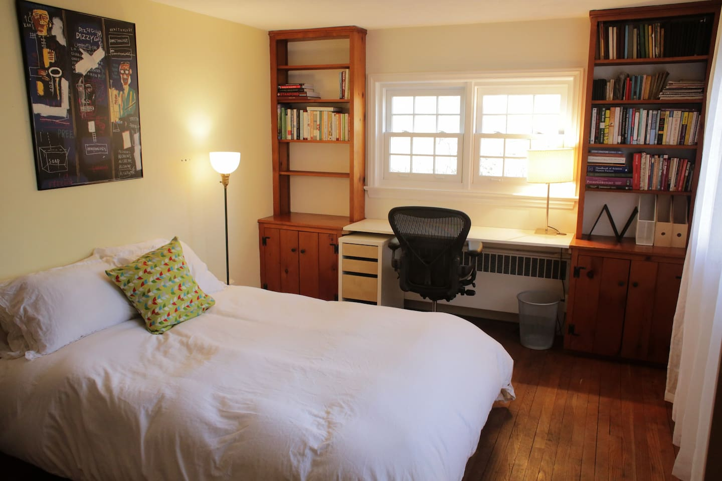 Cozy bedroom has an XL full-size futon with memory foam, a closet and a desk.