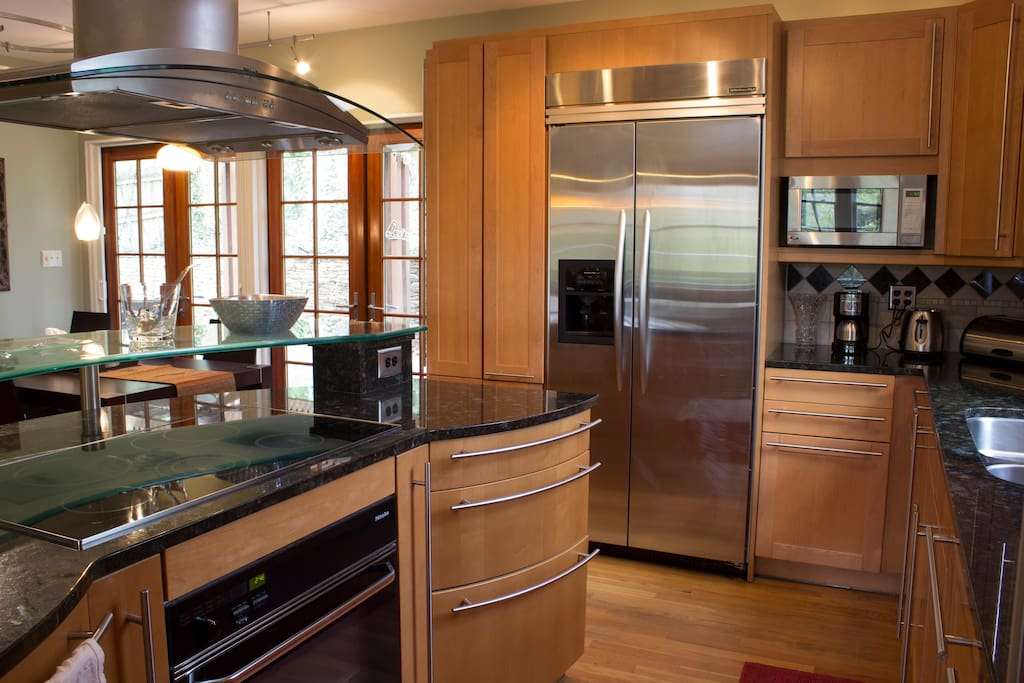 You have a new kitchen equipped with Leitch cabinetry from Germany, Miele appliances, built-in refrigerator, commercial stainless steel vent hood, granite countertops, many built-in pantries, and a lovely breakfast bar!
