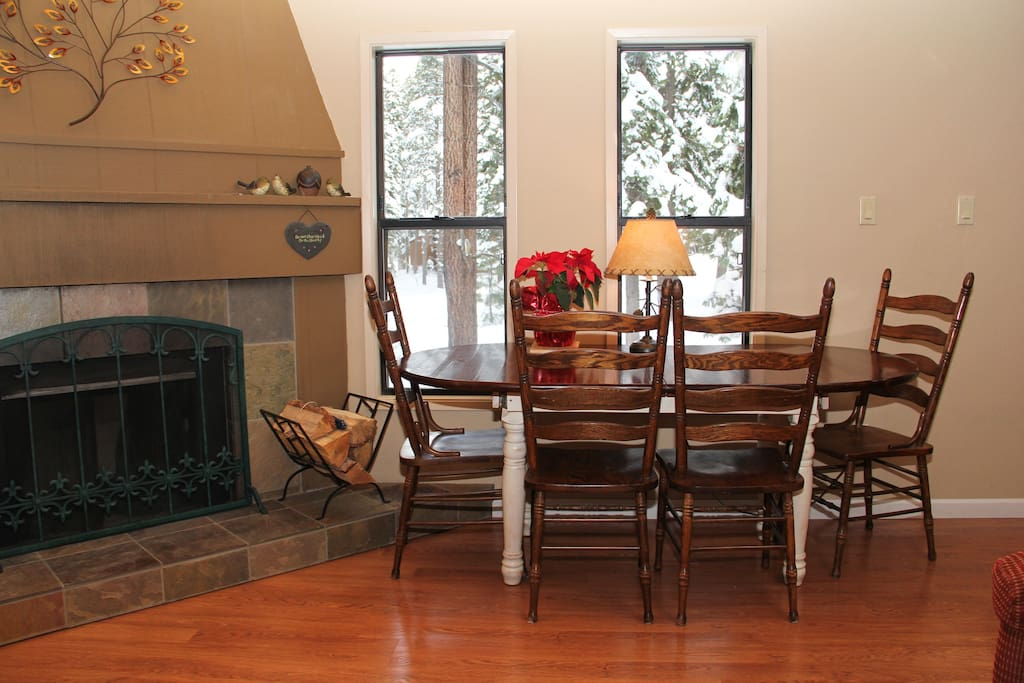 Dining area, fireplace, and view