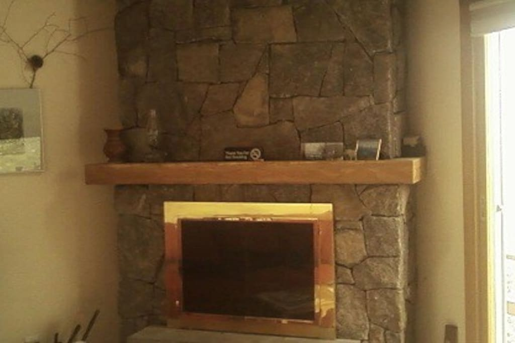 The recent renovation included replacing the old fireplace with a new granite one.