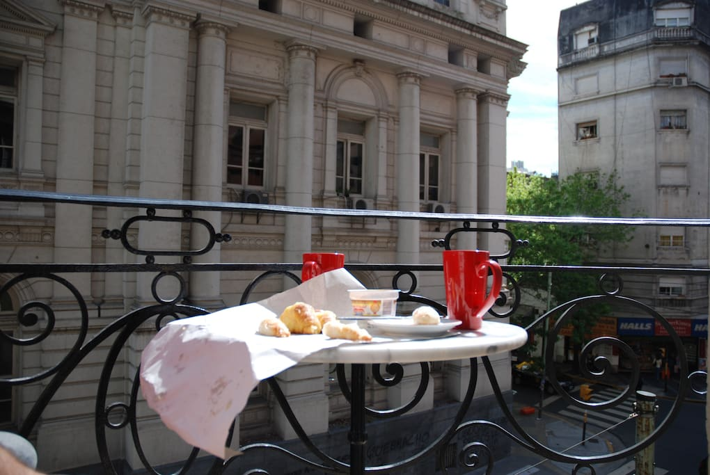 `View from the living room balcony. Enjoy facturas and cafe con leche while enjoying the bustling city buzz below.