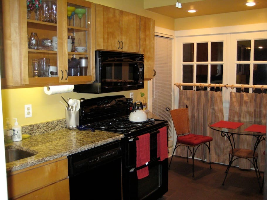 Eat-in kitchen features granite counter tops, dishwasher, microwave, etc.