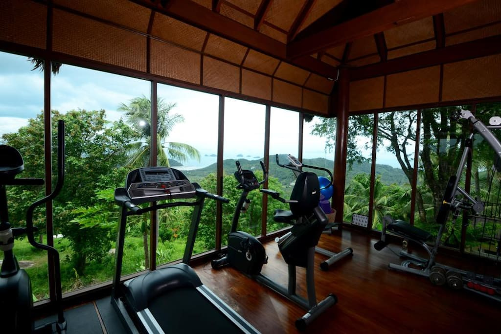 Gym overlooks ocean and has private fitness trainer