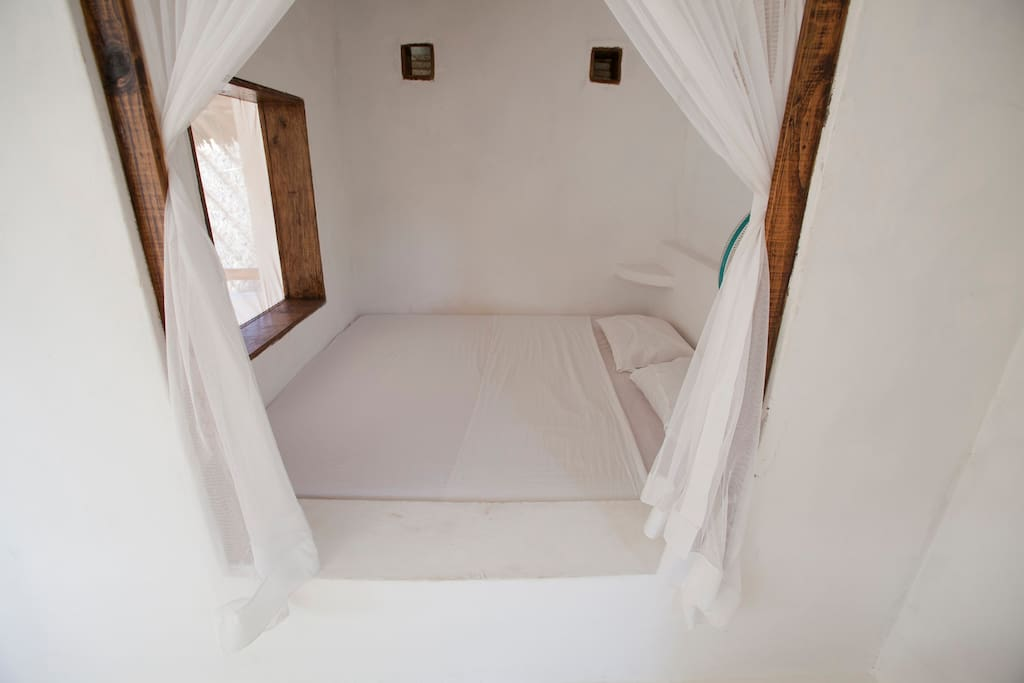 The Lamu/Swahili-inspired bedroom on the first floor of the tower