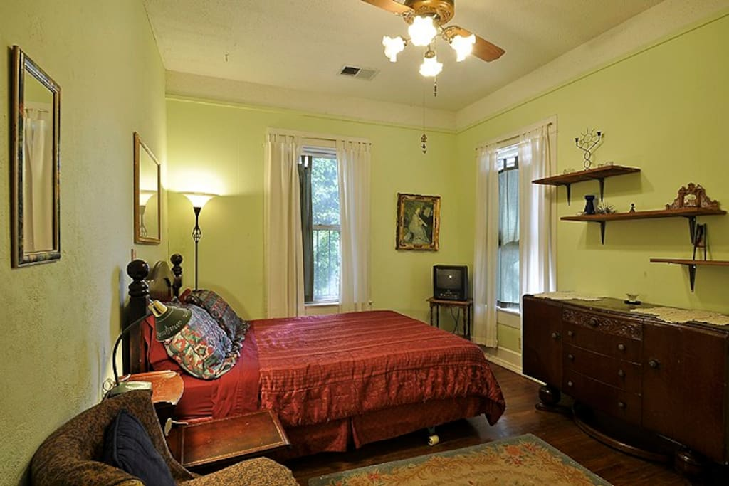 Front Bedroom with a queen bed, ceiling fan and wood floors.