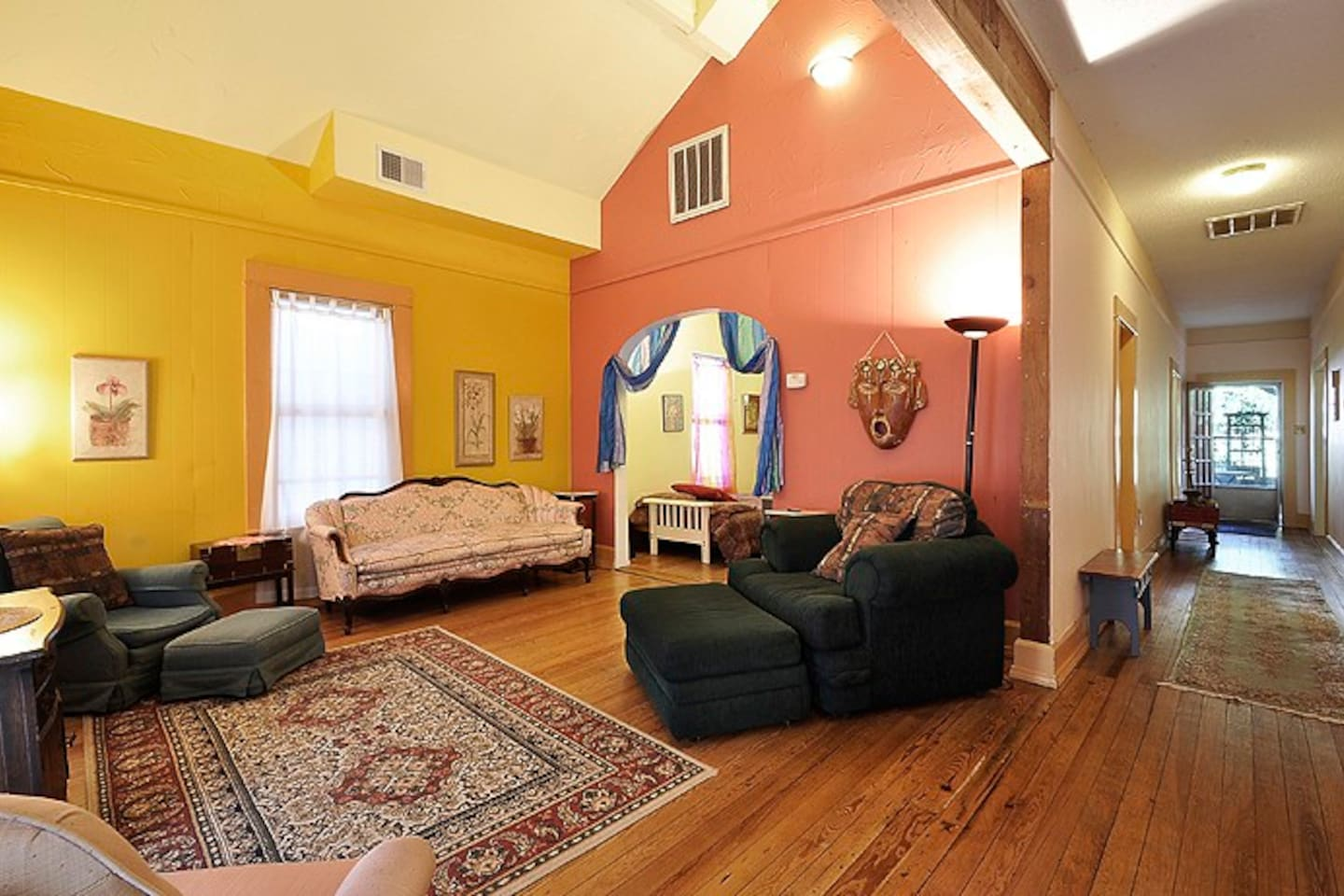 Welcome to the Garden St. House living room.  Vaulted ceilings with vintage and antique furnishings.