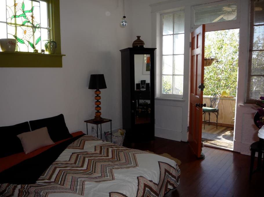 Living room opens to spacious front porch - a great location for morning coffee (or mimosas!)