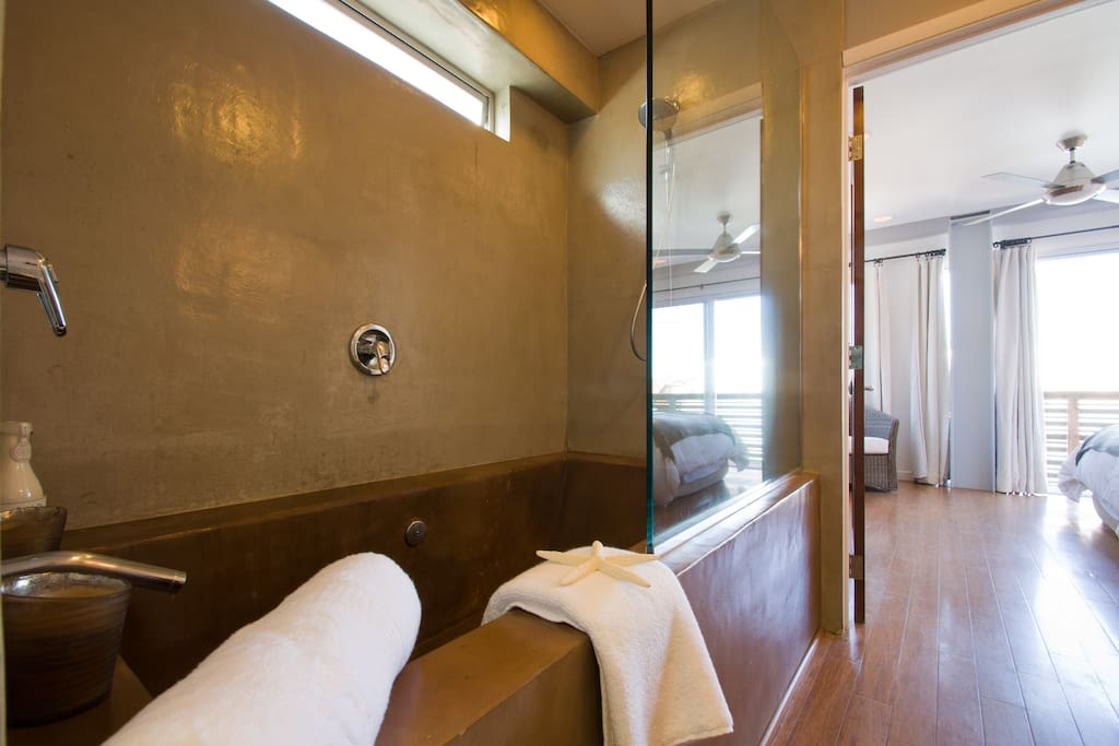 The master bedroom's ensuite bath with large soaking tub for a relaxing soak after a long day at the beach.