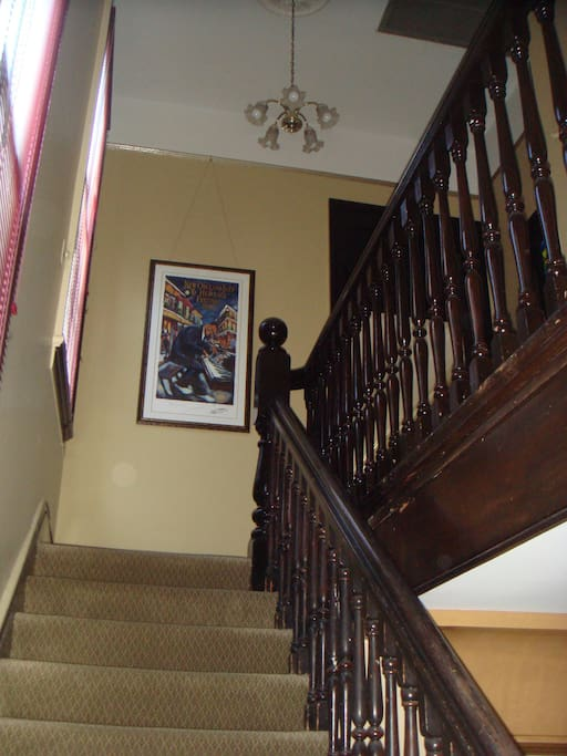 Entry is from the main law office up these stairs. Door to apartment is upstairs to the right.