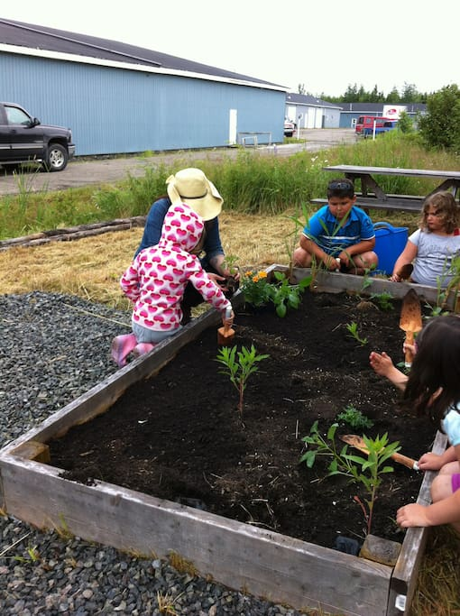 Kids planting food at the local Farmer's Market