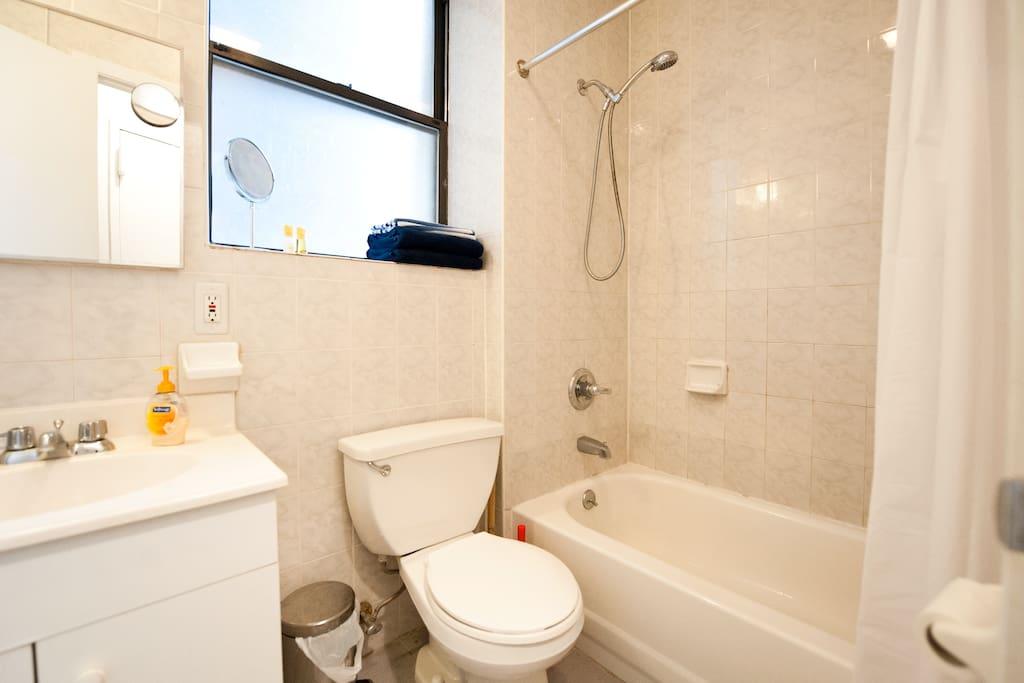 Enjoy a hot shower or bath in the newly renovated bathroom.