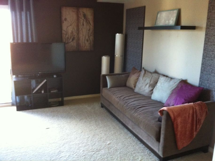 "42"" HDTV and DVD player. Chaise lounge doubles as a twin bed for additional guests."
