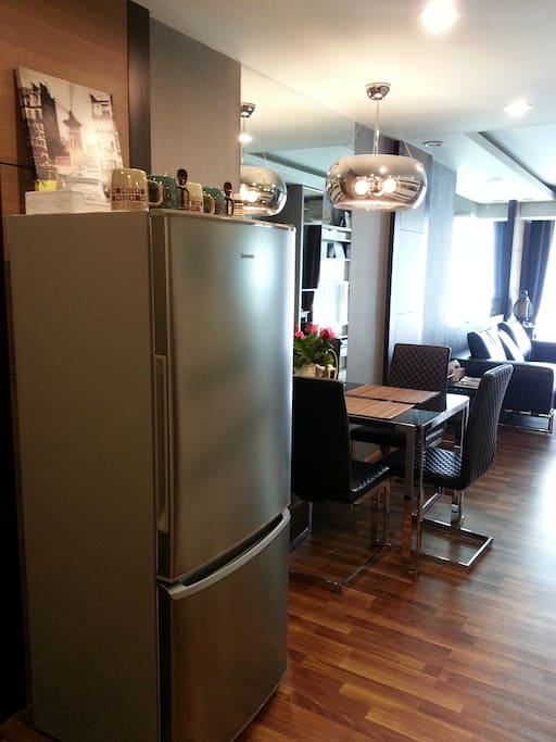Big fridge (with freezer) and view dinner and living room area