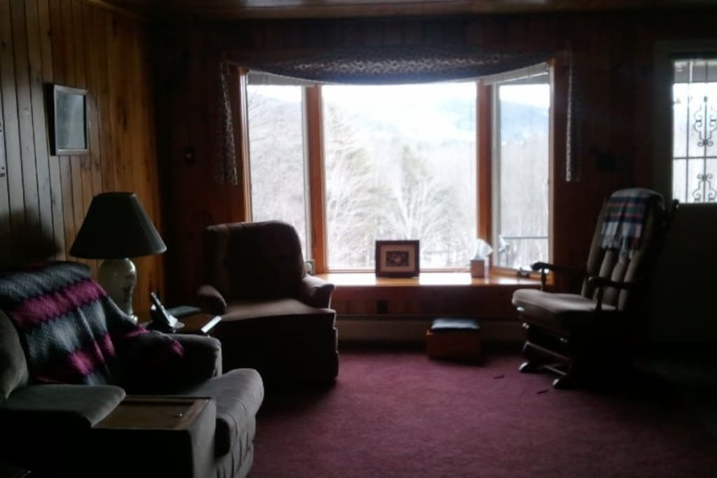 The living room with a view of the mountains - curl up with a book or bring a notebook to write your own short story while you're here.