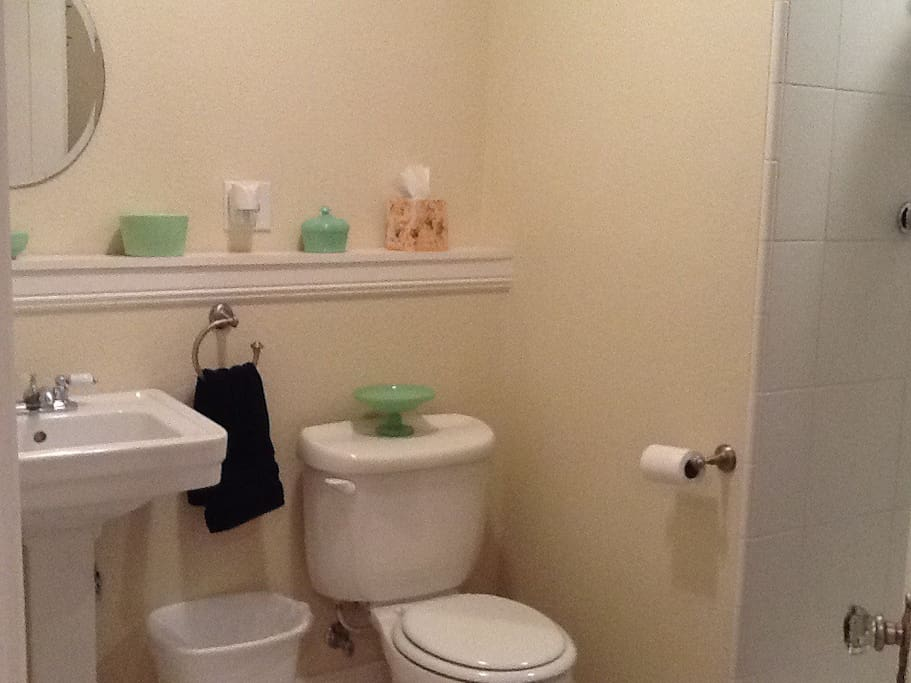 Huge private bath off the kitchen, walk in shower with an AMAZING shower head and bench.