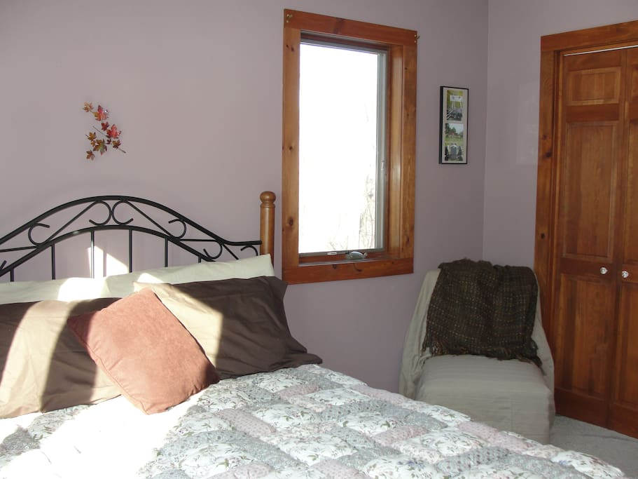 1st floor bedroom w/ queen size bed and views of the farm