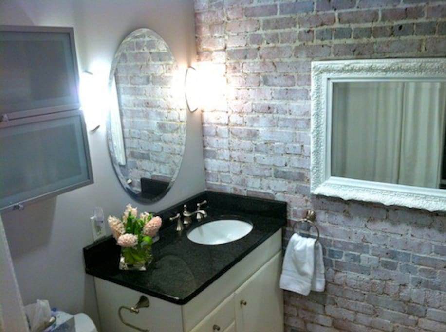 The Bathroom - granite shower/tub, counter tops and floor