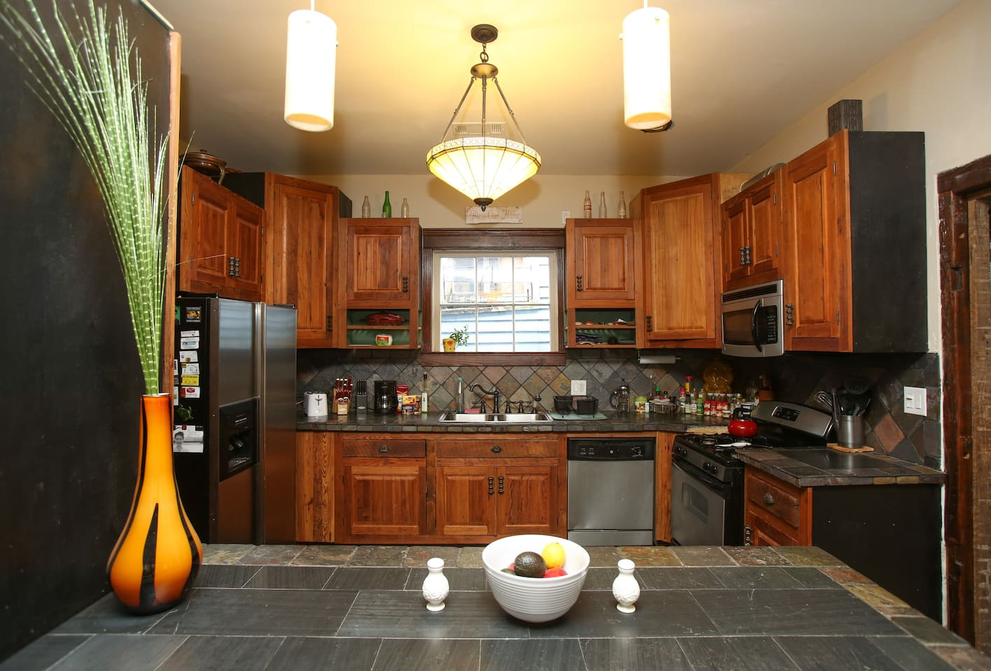 Kitchen with cabinets made from the original heart-pine floors!
