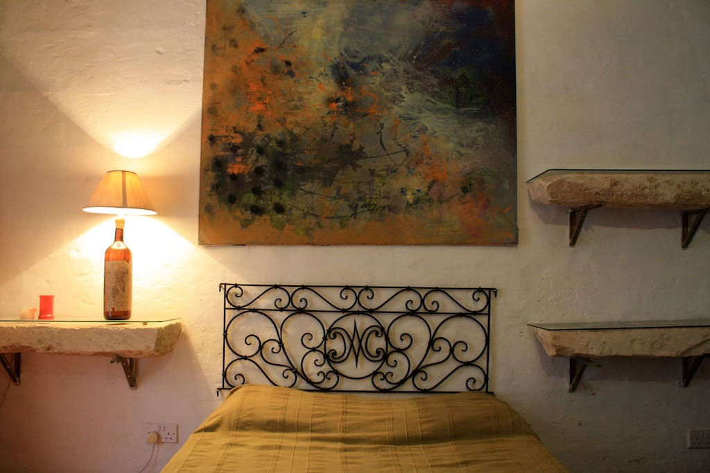 The bed with original baroque wrought iron headstead.