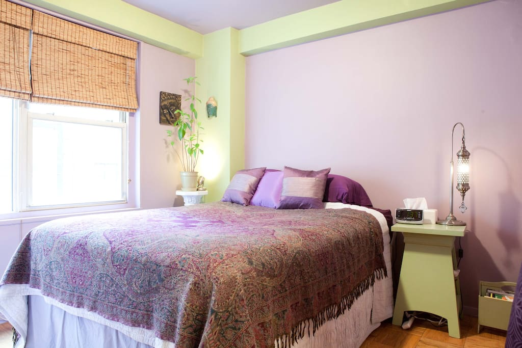 Your quiet bedroom with adjustable reading lights, tv, dvd, alarm clock, black out shades.