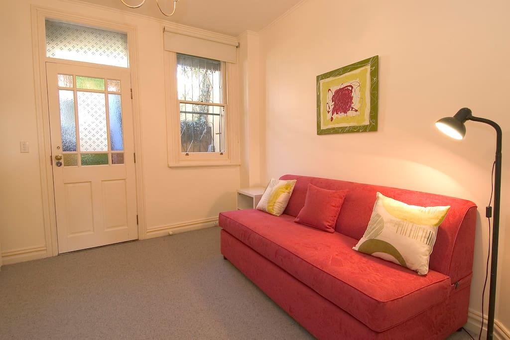 Living room with queen sofa bed. T.V. D.V.D, C.D. player