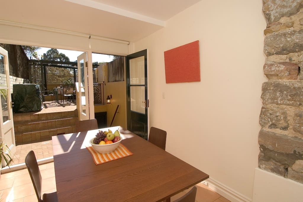 Kitchen, dining area. Doors opening onto garden. Barbecue