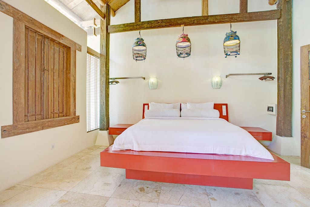 The 1st Bedroom has a King sized bed and lighting created from traditional bird cages.