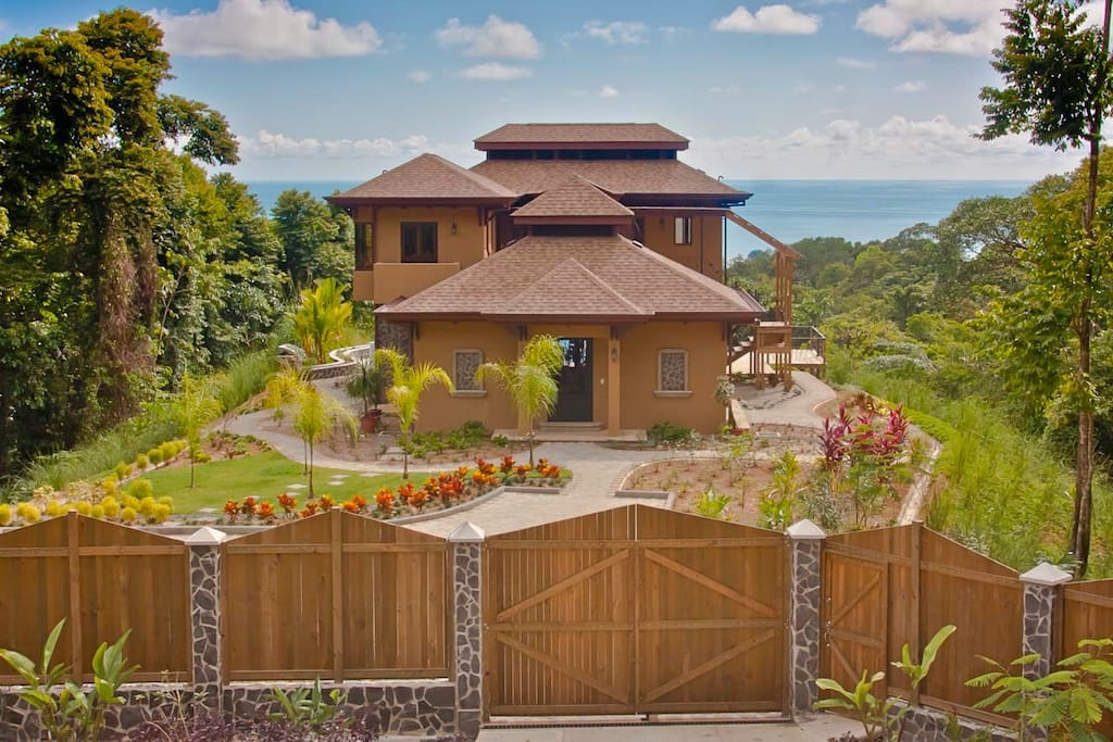 Electric operated entry gates and fence give good security to this private Villa
