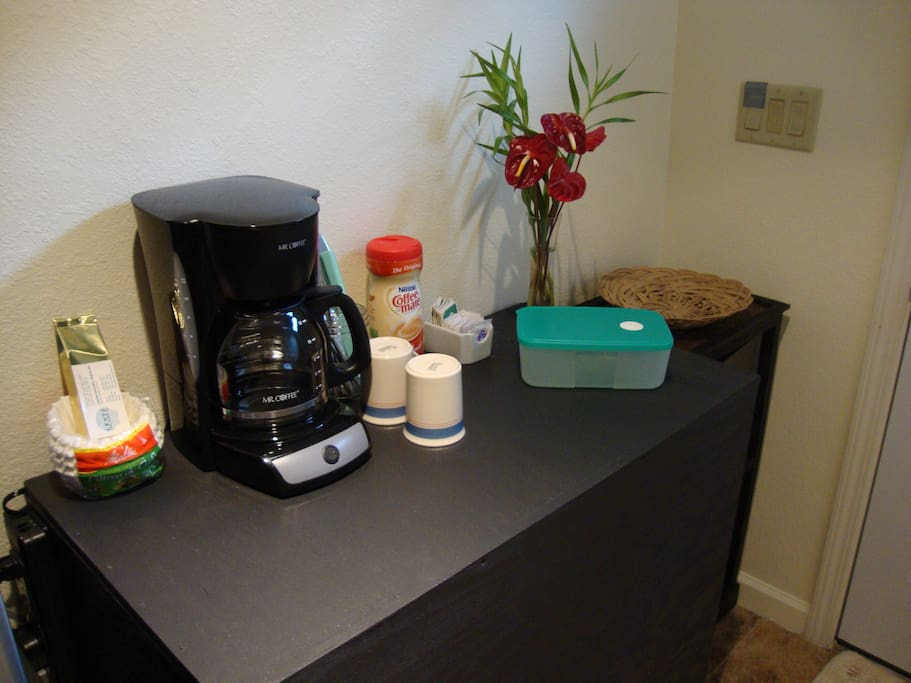 The kitchenette is also equipped with a coffee maker and accessories