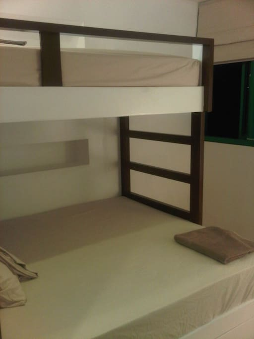 Night time view of the room with Queen sized bed (with single bunk on top).