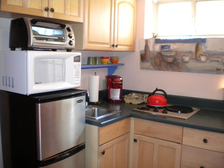 Fully equipped kitchenette with refrigerator, microwave, toaster oven, Krups coffeemaker, tea pot, dishes, silverware and glassware.