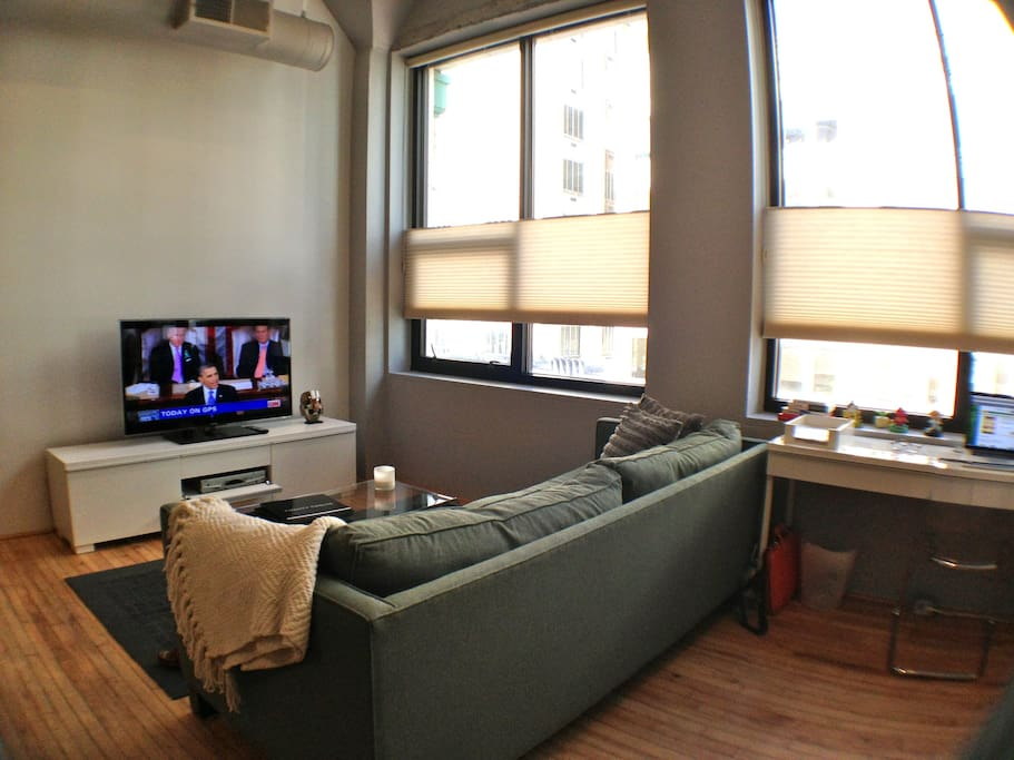 Living room and workspace- Cable, wifi, and basic office supplies here for you