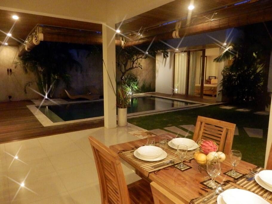 View from Dining Table over Garden and Swimming Pool.