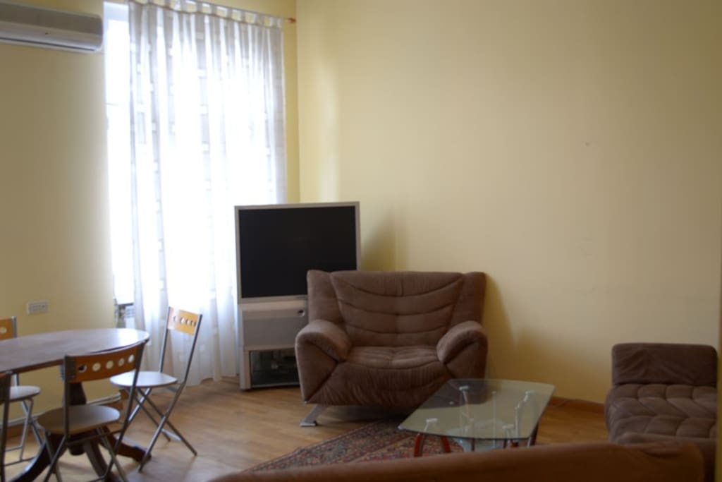 Living room with 2 single sofa and 1 double sofa, where can sleep child until 10 years, 6 chairs, table and free TV,  WiFi