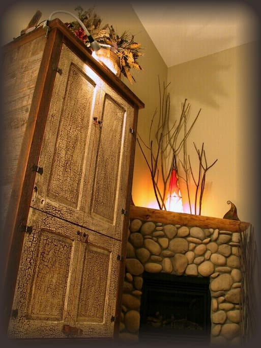 Antique entertainment armoire contains cable TV, surroundsound system, DVD player, books and more!