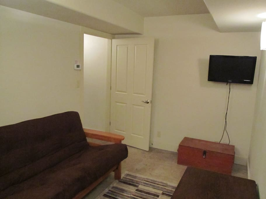 Downstairs sitting area with Fold out Futon bed. Good place for kids and video games!