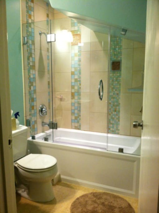 Bathroom remodeled in 2012 with deep soaking tub and loads of sustainable features like recycled glass tiles.