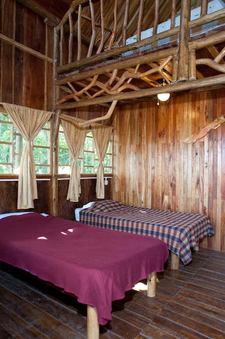 Twin beds on first floor of the Tree House