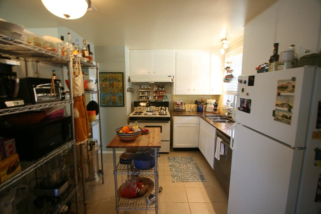 Cozy kitchen with plenty of space for cooking and congregating.