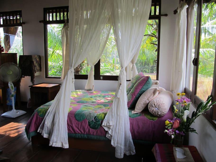 Beautiful, light upstairs bedroom, leading to balcony.