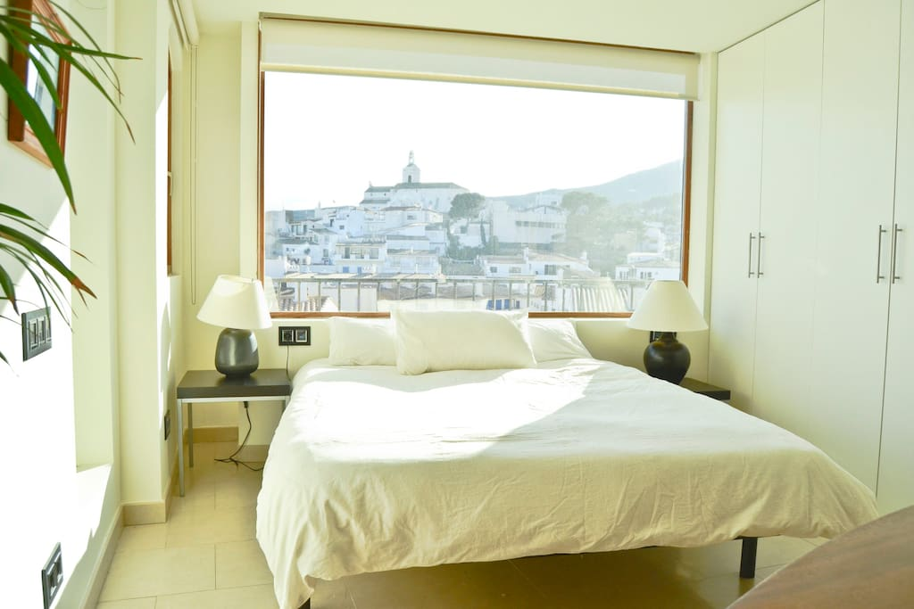 A bed with a view of the old town